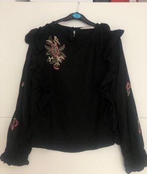 Schwarze Bluse mit Blumenstickerei