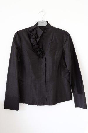 Schwarze Bluse mit Details am Dekolleté