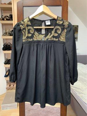 schwarze Bluse mit goldenen Pailletten