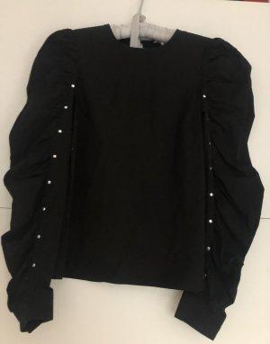 Schwarze Bluse mit Puffärmeln