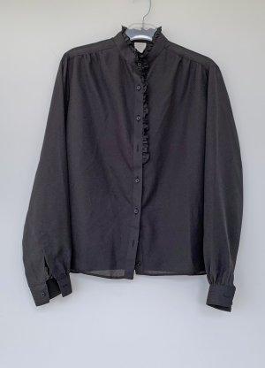 schwarze Bluse mit Rüschen, Größe 40