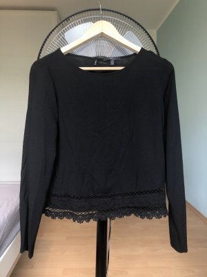 Schwarze Bluse mit Spitzenrand