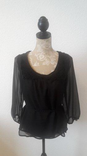 Schwarze Bluse mit transparenten Ärmeln