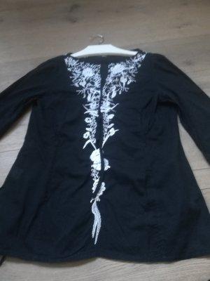 Schwarze Bluse mit weißen Stickereien