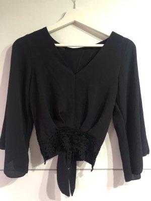 Schwarze Bluse mit Wickelung