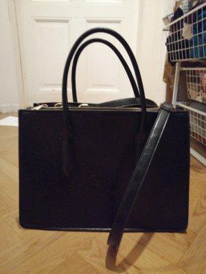 Schwarze businesshandtasche