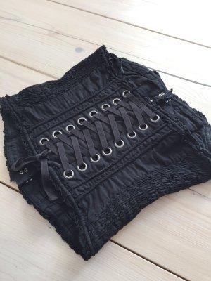 schwarze Corsage mit silbernen Haken
