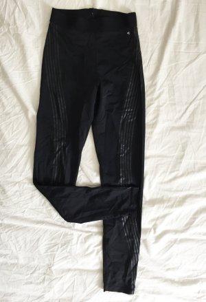 Schwarze elastische Sporthose / Jogginghose mit glänzenden Streifen