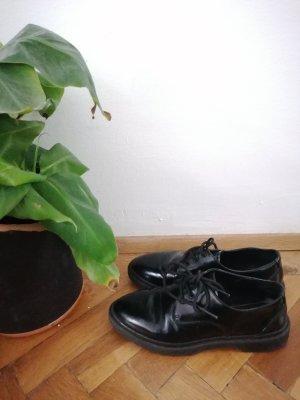 Schwarze Flache Schuhe