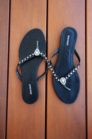 Schwarze Flip-Flop-Sandale