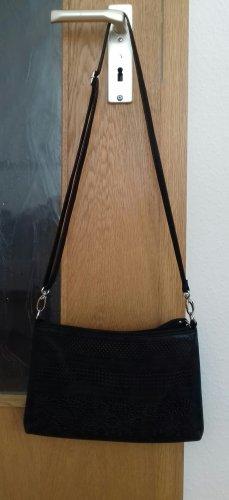 Schwarze gemusterte Tasche
