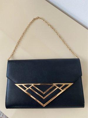 Schwarze Handtasche mit goldenen Details