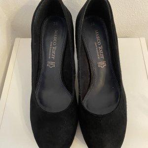 Schwarze hohe Schuhe