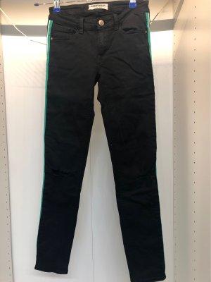 Schwarze jeans mit Löchern und Bunter Naht