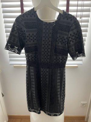 Schwarze Kleid aus Kunstleder