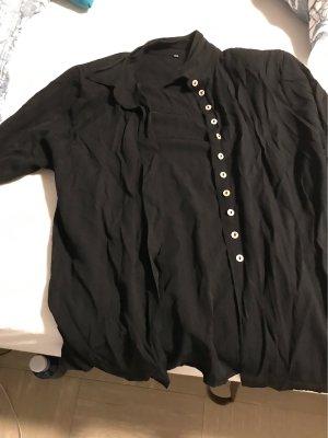 Schwarze kurzarm Bluse mit schulterpolstern