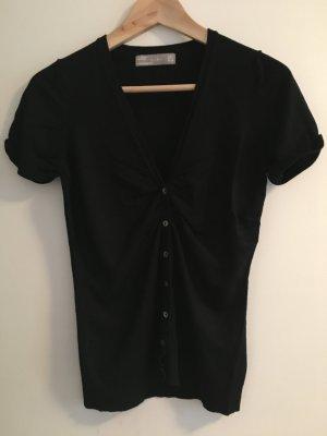 Schwarze Kurzarmweste von Zara.