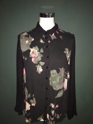 Schwarze Langarmbluse mit floralem Muster