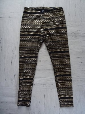 Schwarze Leggings mit goldenem Muster