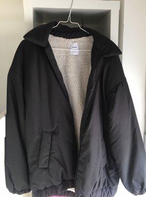 schwarze oversized subdued jacke