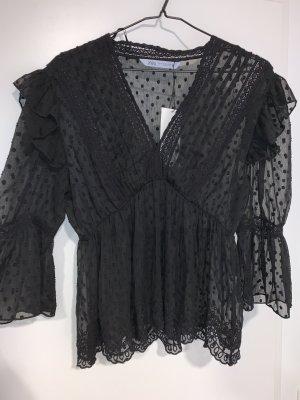 Schwarze Plumetis-Bluse mit Volant Gr. S