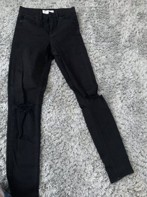 Schwarze Ripped Jeans