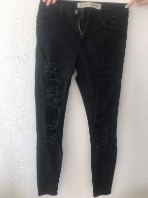 Schwarze Ripped Jeans in Größe 36