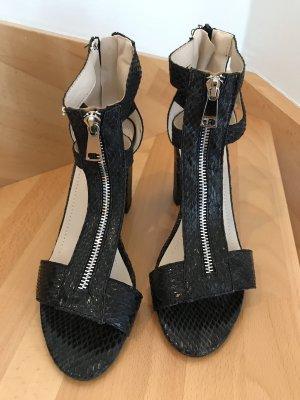 Sandalias de tacón con barra en T negro