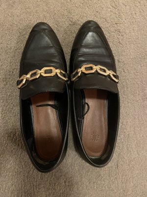 Slippers black-gold-colored