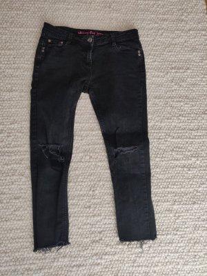 Schwarze Skinny Jeans frayed hem Ankle Hose destroyed Fransen