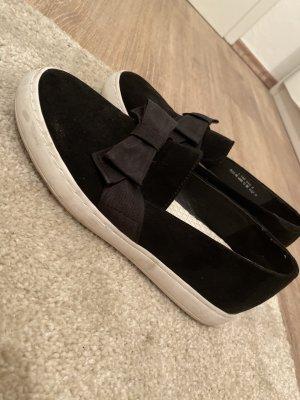 Schwarze Slip-on Schuhe