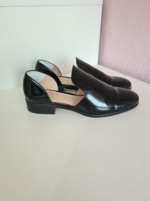 schwarze Slipper von H&M