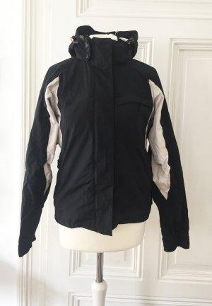 Schwarze Snowboardjacke / Outdoor Jacke mit weißen Details