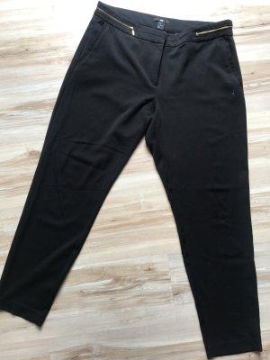 Schwarze Stoffhose mit goldenen Reißverschlüssen