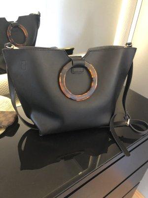 Schwarze Tasche Kunstharz