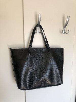 Schwarze Tasche mit Schlangenmuster