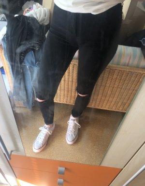 Schwarze Topshop Jeans mit Rissen an den Knien in 28/34