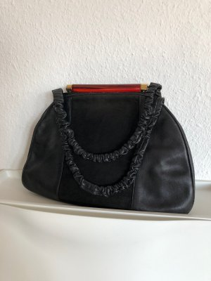 Schwarze Vintage-Handtasche mit schönem Verschluss