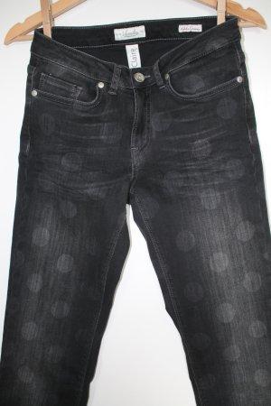 Schwarze Washed out - Jeans mit großen Punkten