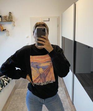 Schwarzer Pullover mit Bild