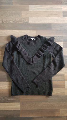 Schwarzer Stick Pulli mit Rüschen