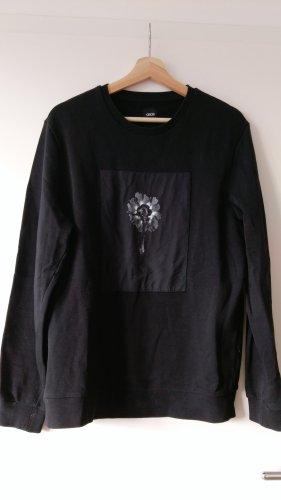 Schwarzer Sweater mit Blumenmotiv