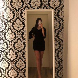 schwarzes enges Partykleid