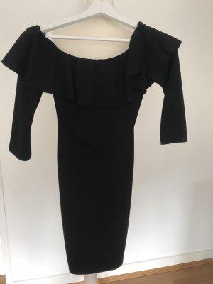 Schwarzes hautenges Kleid mit freien Schultern