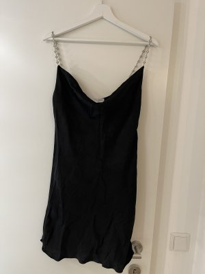 Schwarzes Kleid aus Seide mit Glitzerdetails