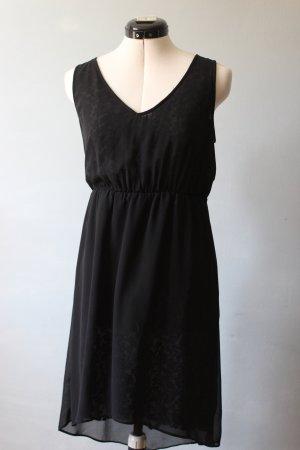 Schwarzes Kleid mit durchscheinendem Spitzenmuster