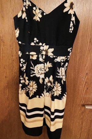 Schwarzes Kleid mit gelben Details