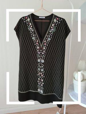Schwarzes Kleid mit Glitzer Print und Blumen