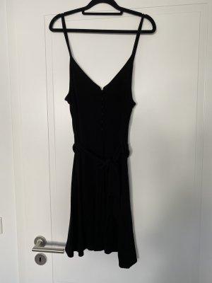 Schwarzes Kleid mit Knöpfen am Oberteil von Mango