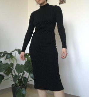 Schwarzes kleid mit knoten